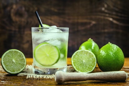 Brazilian Caipirinha, typical Brazilian cocktail made with lemon, cachaça and sugar. Traditional brazil drink, isolated with space for text.