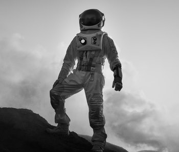 Silhouette of the Astronaut Standing on the Rocky Mountain of the Alien Red Planet/ Mars. First Manned Mission on Mars. Space Exploration, Colonization.