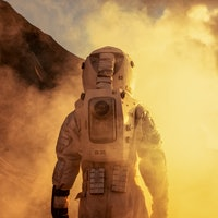 Courageous Astronaut in the Space Suit Explores Red Planet Mars Covered in Mist. Adventure. Space Tr...