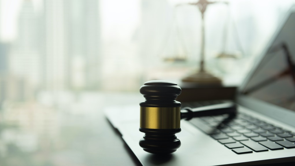 law legal technology concept. judge gavel and computer on desk of lawyer with legal icon.