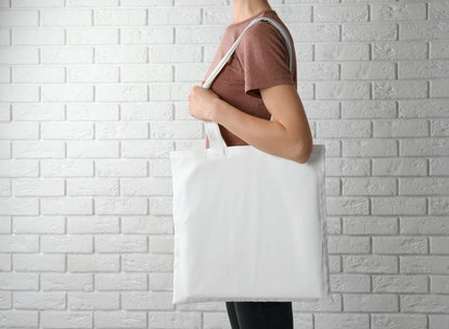 Switching from plastic bags to reusable tote bags is one way to live more sustainably.