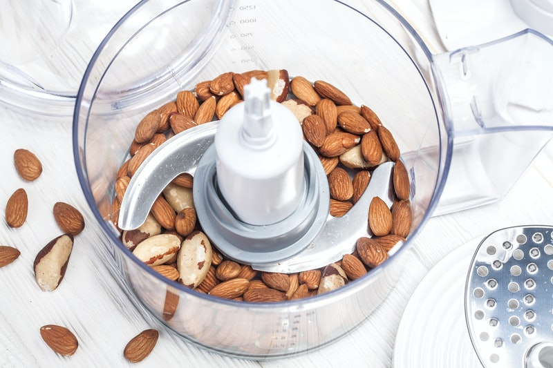 almonds in a food processor ready to be crushed for prepare dessert