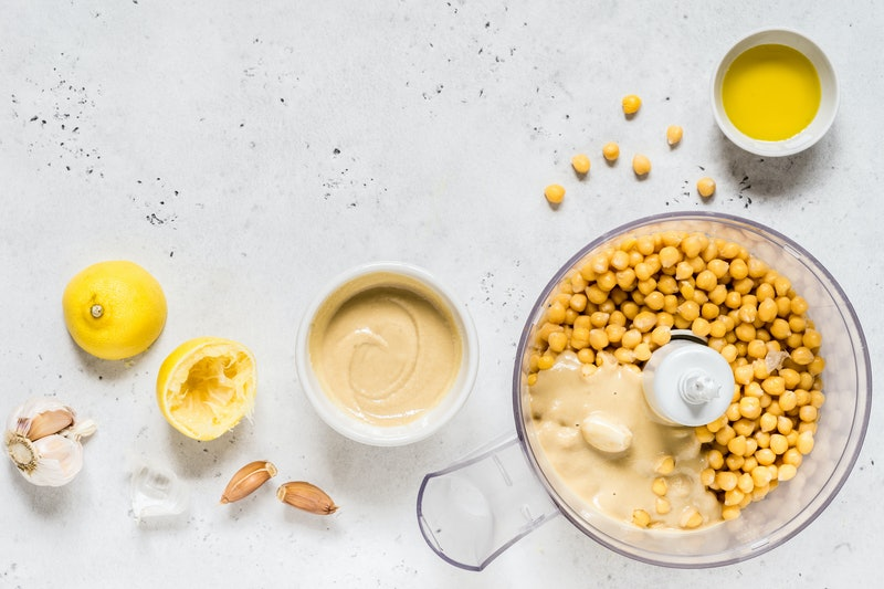 Hummus Ingredients, Houmous Being Made in a Food Processor, copy space for your text