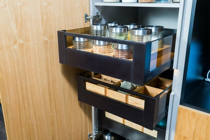 Sliding drawers help with deep kitchen cupboard for food storage.