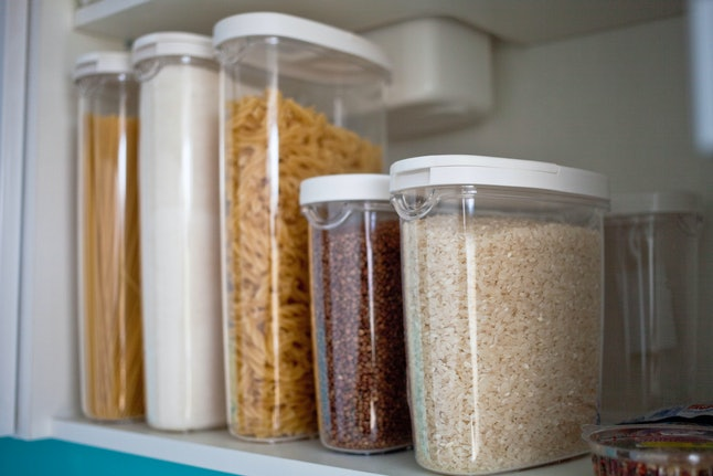Storing food in air tight plastic containers helps with pantry organization.