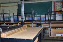 The atmosphere of the classroom in after school time, every student's chair is lifted.