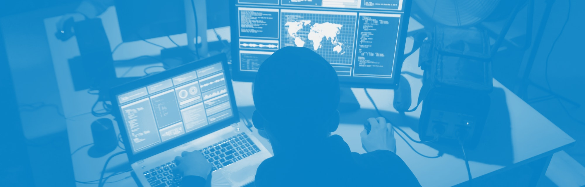 Wanted hackers coding virus ransomware using laptops and computers. Cyber attack, system breaking an...