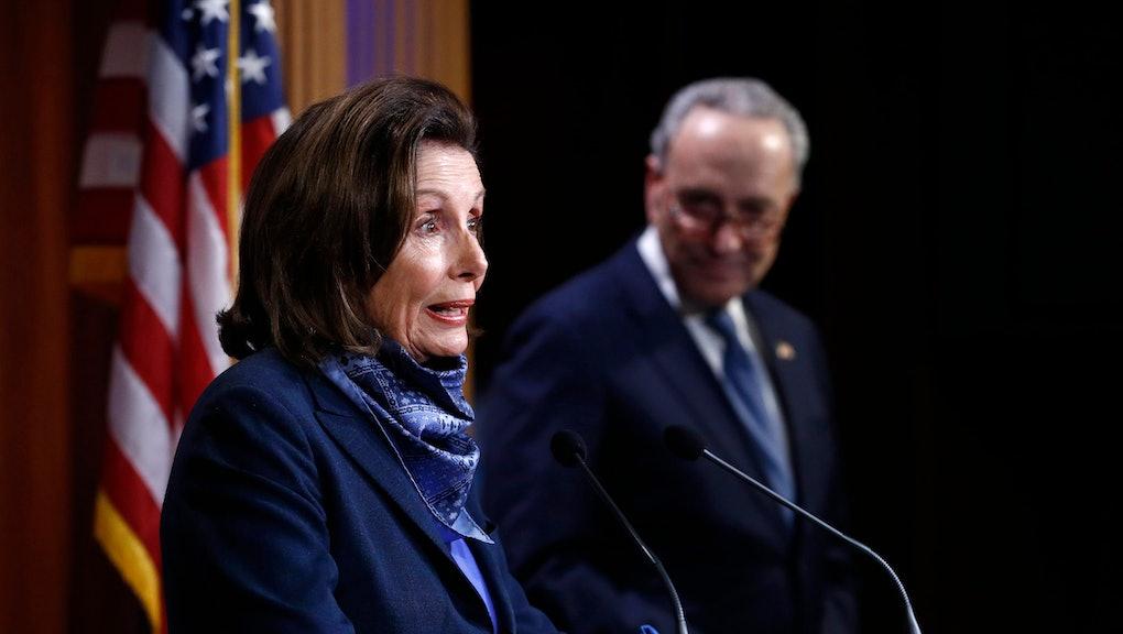 House Speaker Nancy Pelosi of Calif., speaks with reporters alongside Senate Minority Leader Sen. Ch...