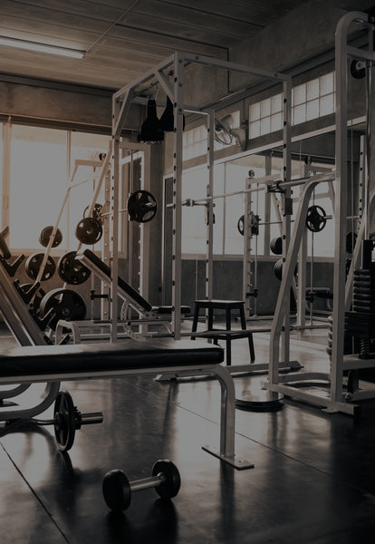 Within gym with modern fitness equipment for fitness events and more. Modern of gym interior with equipment. Sports equipment in the gym.