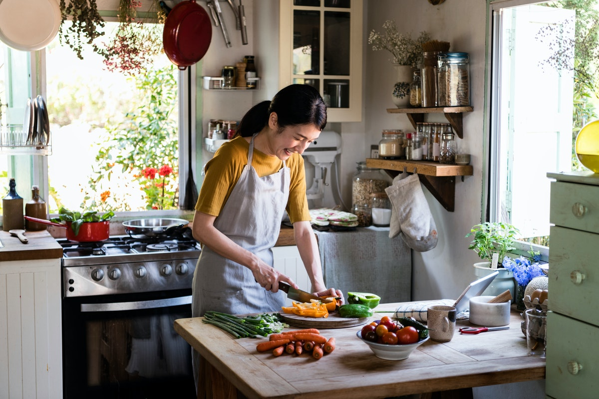 Japanese woman cooking in a countryside kitchen