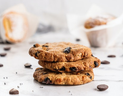American chocolate chip cookies with chocolate on light marble background. Delicious dessert, close up