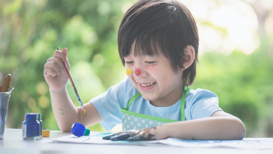 kid crafting a mother's day gift