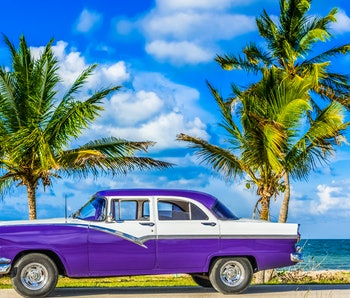 Havana, Cuba - June 30, 2017: HDR - American blue classic car parked on the Malecon near the beach in Havana Cuba - Serie Cuba Reportage