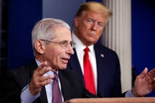 President Donald Trump watches as Dr. Anthony Fauci, director of the National Institute of Allergy a...
