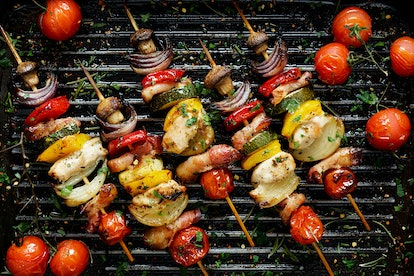Grilled vegetable and meat skewers in a herb marinade on a grill pan, top view