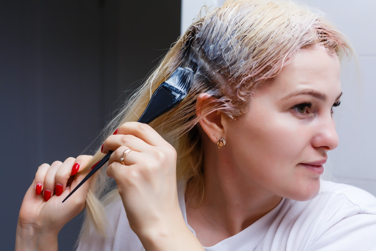 The process of hair coloring,hair coloring,Hair Colouring in process,Woman gets new hair colour,Hair Colouring in process