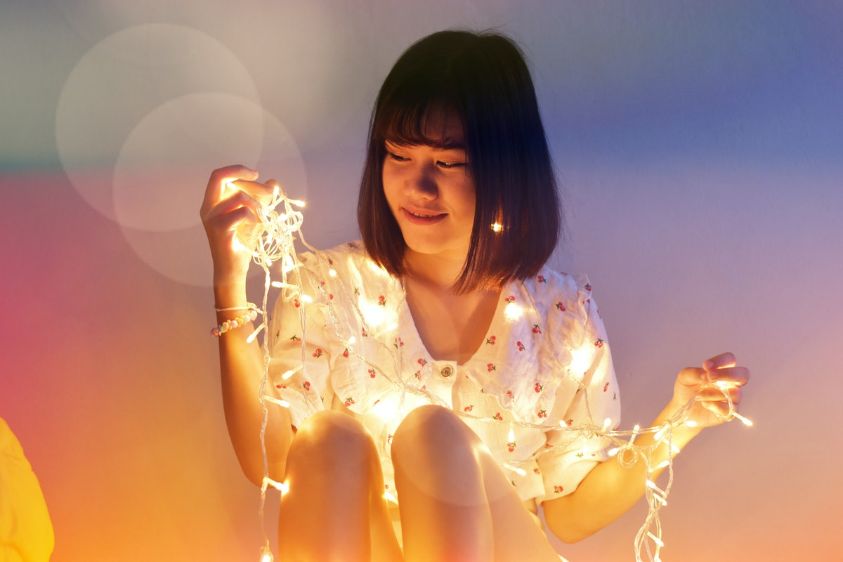 Women with LED String Light and illuminated at night