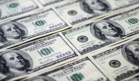 Closeup American dollars banknotes background. US dollars pattern. 100 dollars, Mr. Franklin