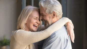 Happy mature couple in love embracing, laughing grey haired husband and wife with closed eyes, horizontal banner, middle aged smiling family enjoying tender moment, happy marriage, sincere feelings