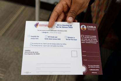 """Coalition for Humane Immigrant Rights, CHIRLA volunteer Angeles Rosales holds up a CHIRLA """"Contamos ..."""