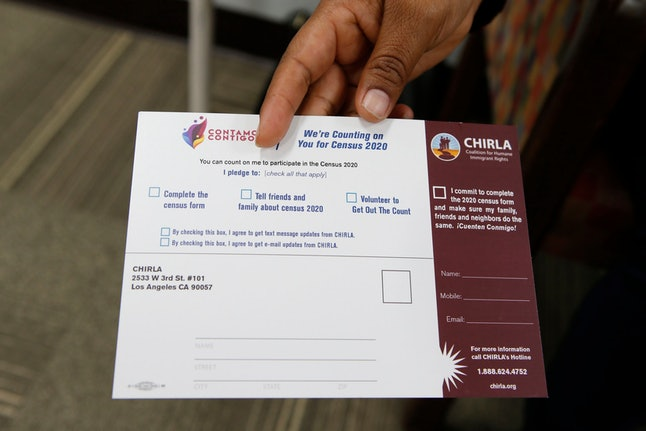 """Coalition for Humane Immigrant Rights, CHIRLA volunteer Angeles Rosales holds up a CHIRLA """"Contamos Contigo,"""" """"We Count with You"""" census campaign card at the CHIRLA offices in Los Angeles. It's not just Democratic-leaning states at risk of losing federal money and clout in Congress if the Supreme Court says the upcoming census can include a citizenship question. Fast-growing Arizona, Florida and Texas all have large groups of immigrants, especially Hispanics, who might choose to sit out the census, but are led by Republicans who seem unconcerned about the potential for an undercount and the resulting loss of representation in Congress"""