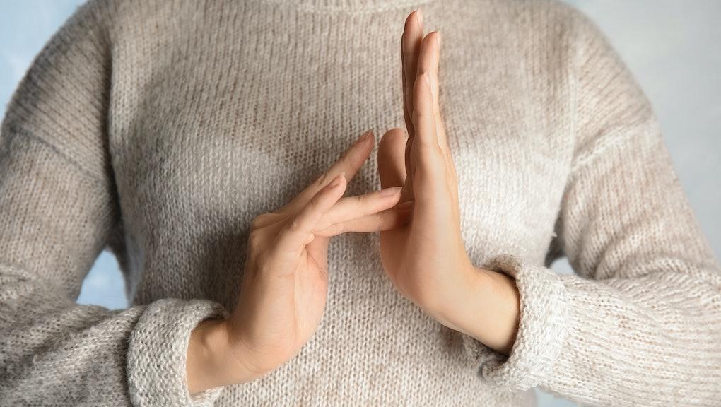 Woman showing word Jesus, closeup. Sign language
