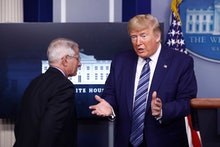 President Donald Trump speaks as Dr. Anthony Fauci, director of the National Institute of Allergy an...