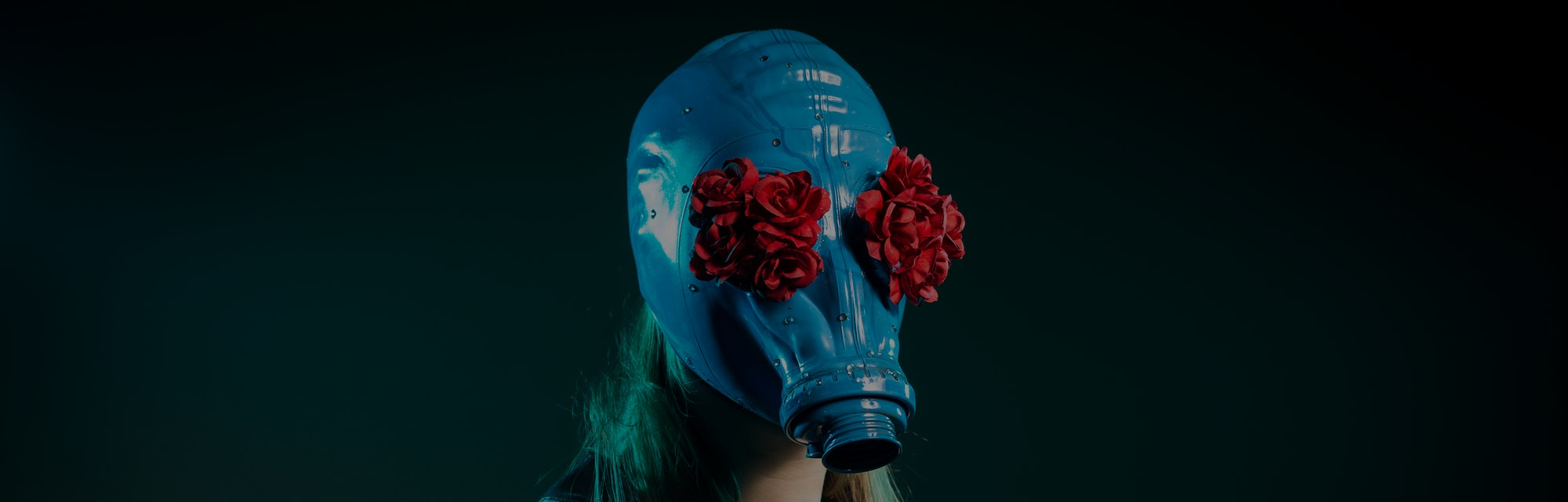 Girl in a blue gas mask on a green background