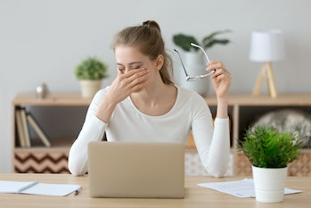 Tired young woman student feeling eye strain bad blurry vision rubbing dry irritated eyes taking off glasses after computer work, fatigued teen girl suffer from discomfort tension problem concept