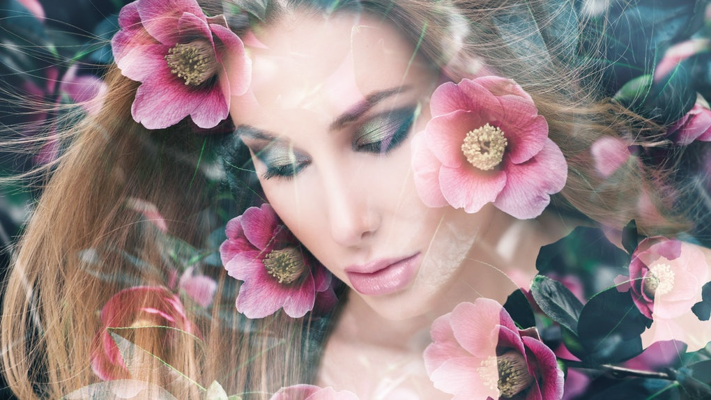 Double exposure portrait of pretty woman combined with photograph of blossoming garden flowers. Conceptual image showing unity of human with nature, beauty of youth and femininity
