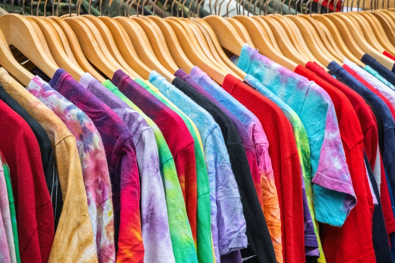 Second-hand T-shirts on display at Broadway Market, a street market in Hackney, East London