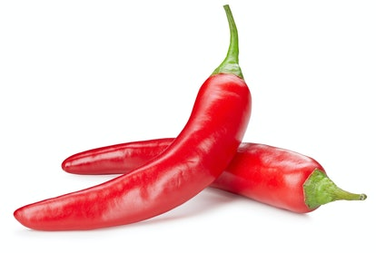 Heating hot peppers and chilis in the microwave oven may release capsaicin.