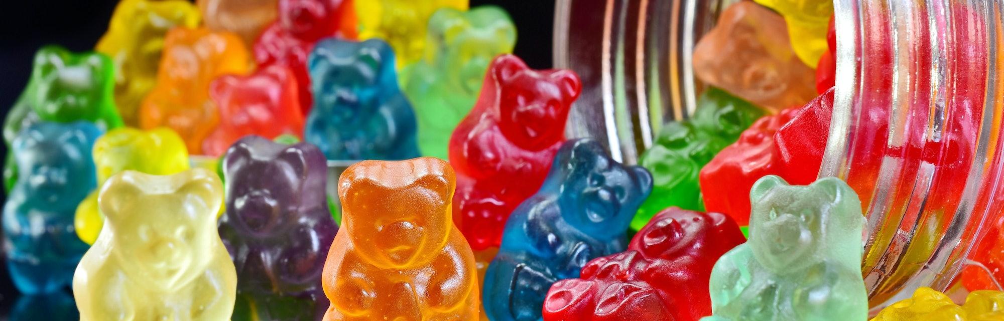 Gummy bears on the beach background