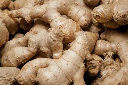a lot of ginger. A lot of Ginger Root. ginger harvest. ginger root food background. closeup photo / ...