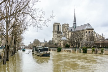 View of the swollen Seine at the foot of Notre-Dame de Paris cathedral, during the winter flooding episode of January 2018, causing the riverboats moored at the Montebello port to be inaccessible.