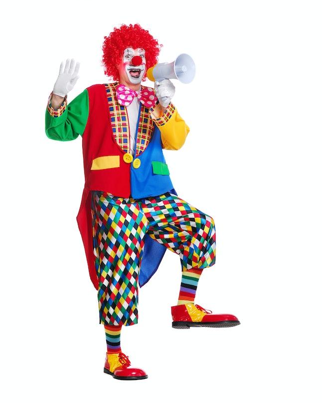 Happy clown screaming into loudspeaker making wide steps