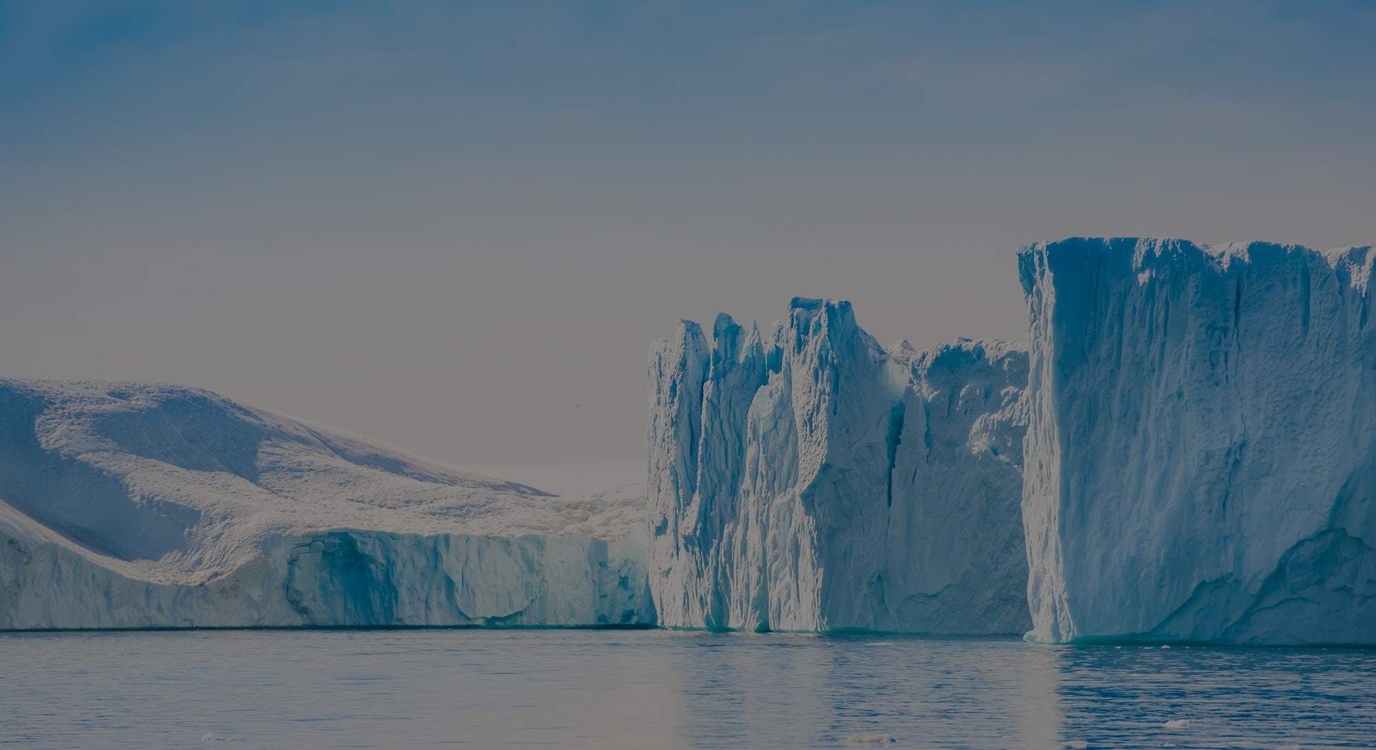 Big blue icebergs in Ilulissat icefjord, western Greenland