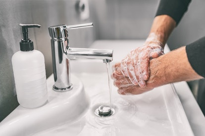 Washing hands rubbing with soap man for corona virus prevention, hygiene to stop spreading coronavirus.