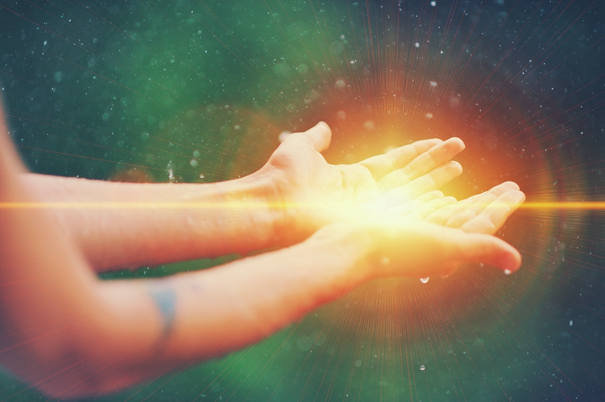 Woman hands praying for blessing from god, blurred nature background, rain, day. Religious human ope...
