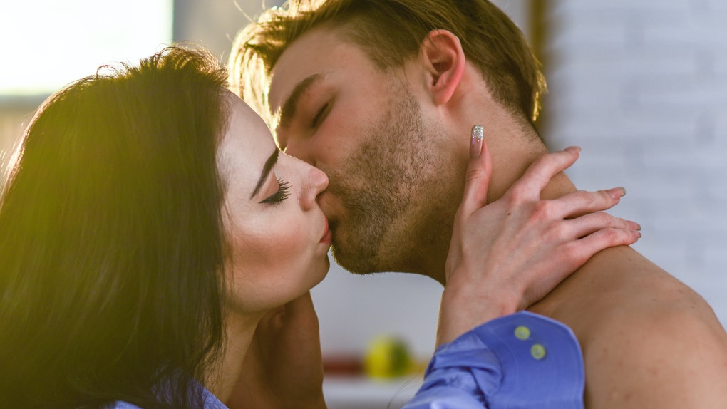 Seduction and foreplay. Celebrate valentines day. Sensual kiss of lovely couple close up. Passionate kiss concept. Couple in love kissing with passion. Man and woman attractive lovers romantic kiss.
