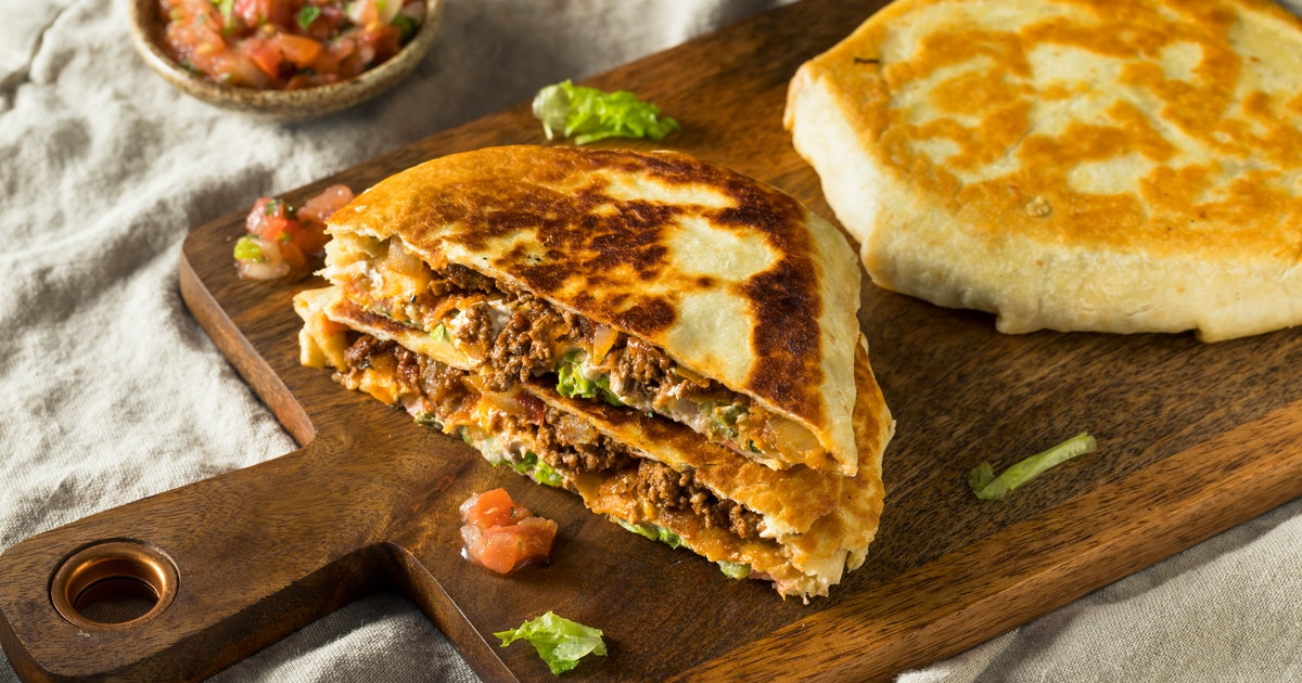 You Can Make Taco Bell's Crunchwrap Supreme At Home, In Queso You're Hungry