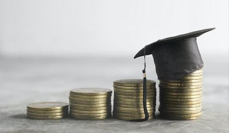 congratulations graduates on top of the money scholarship money background concept.