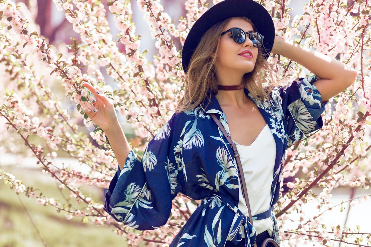 Summer  romantic  image of  stylish casual woman in sunglasses and hat , trendy silk blouse and fash...