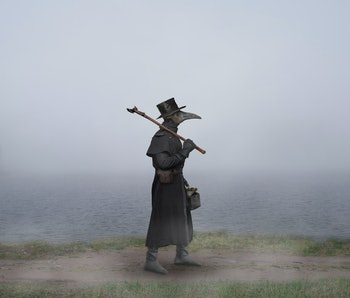 Medieval era. The plague doctor walks along the road near the misty lake
