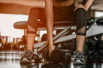 Women exercising on the running machine are wiping their own sweat after the exercise is complete.