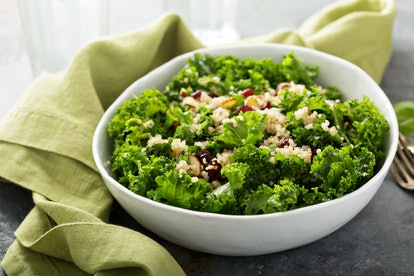 Fresh healthy salad with kale, almond, cranberry and quinoa
