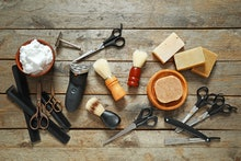 Set for male shaving on wooden background