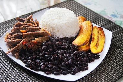 Homemade Venezuelan food. Traditional Venezuelan dish. Pabellon Criollo. White Rice, Black beans,Fri...