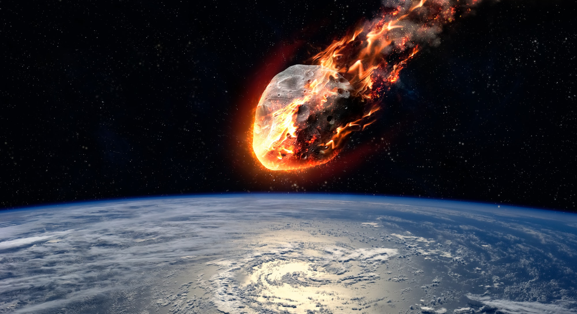 A Meteor glowing as it enters the Earth's atmosphere. Elements of this image furnished by NASA