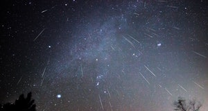 Geminid meteors shower downward in this composite image taken over several hours on a December night...